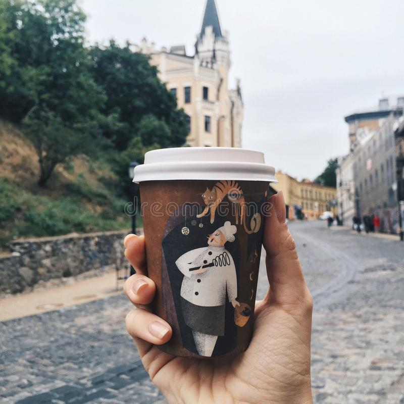 Cup of coffee in cold city Kiev near castle of Richard stock images