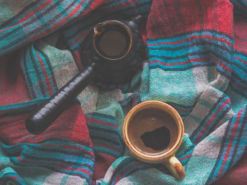 A Cup of coffee and colored textiles. Comfort on cold days. Home comfort. A Cup of coffee and colored textiles royalty free stock images
