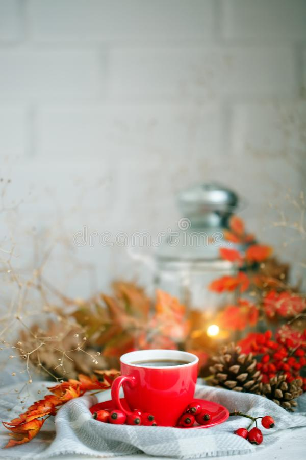 Cup of coffee, cones and autumn leaves on a wooden table. Autumn background. stock photo