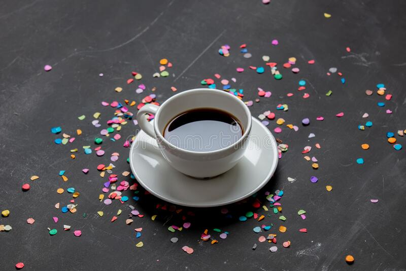 Cup of coffee and confetti on a table stock photography