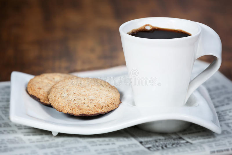 Cup of coffee and a cookie. Cup of coffee and cookie stock image