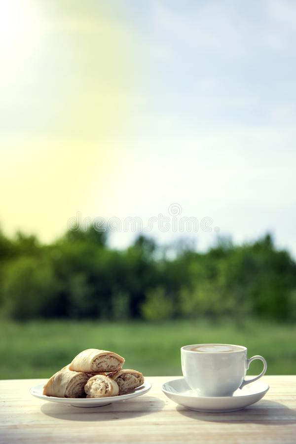 Download Cup Of Coffee And Cookie On Wooden Table In The Summer Garden. Stock Photo - Image of cafe, break: 117122496
