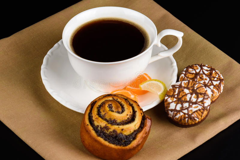 Cup of coffee and cookies close up on a black. Background royalty free stock photos