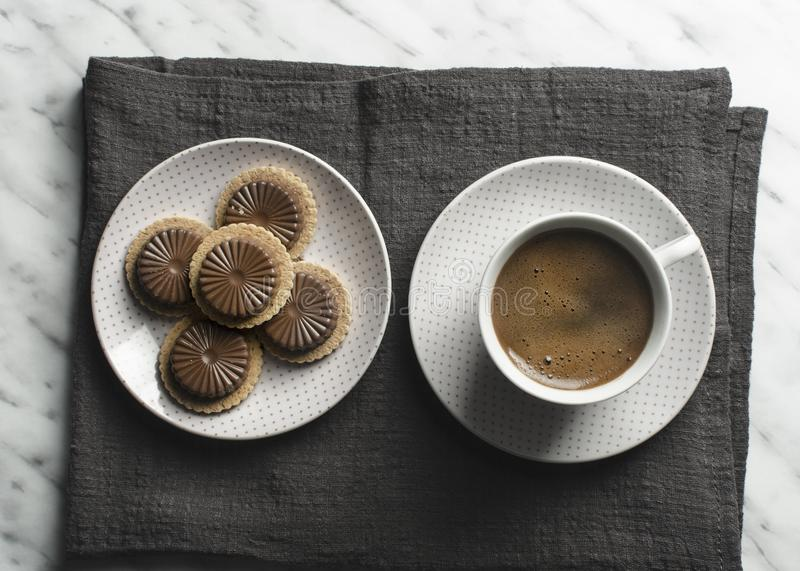 Cup of coffee with cookies on marble table. Top view stock photos