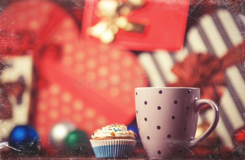 Cup of coffee and cupcake. On christmas background royalty free stock photography