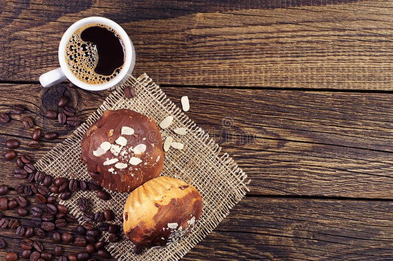 Cup of coffee and cupcake royalty free stock photo