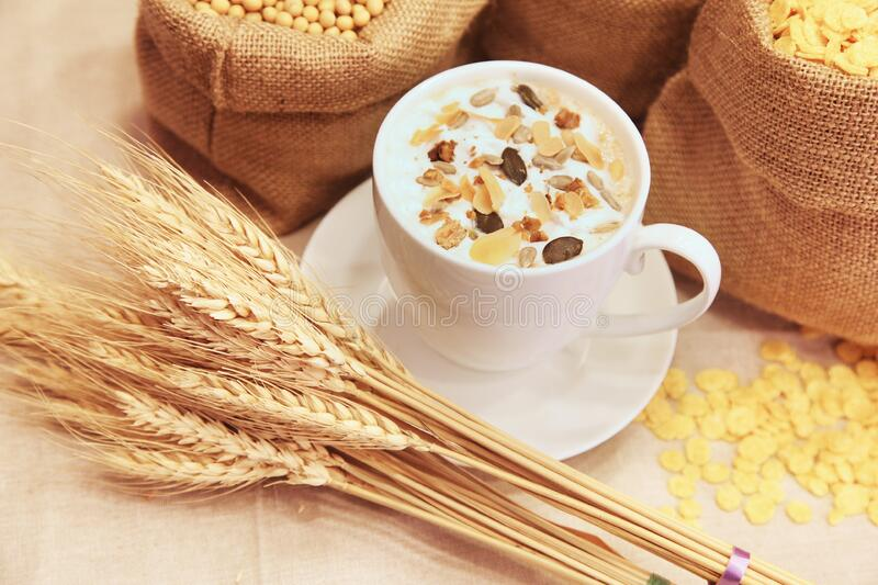 Cup of coffee decorated with cereal royalty free stock image