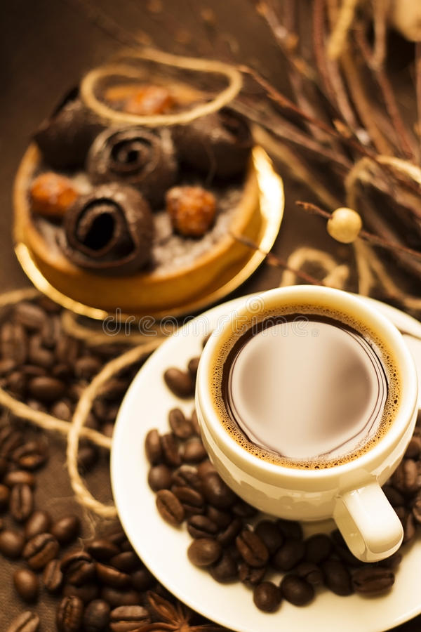 Cup of coffee espresso with dessert tart and coffee beans. Cup of coffee espresso with chocolate dessert tart and coffee beans royalty free stock photo