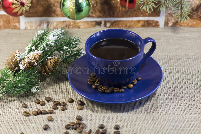 A Cup of coffee and fir-tree branch stock image
