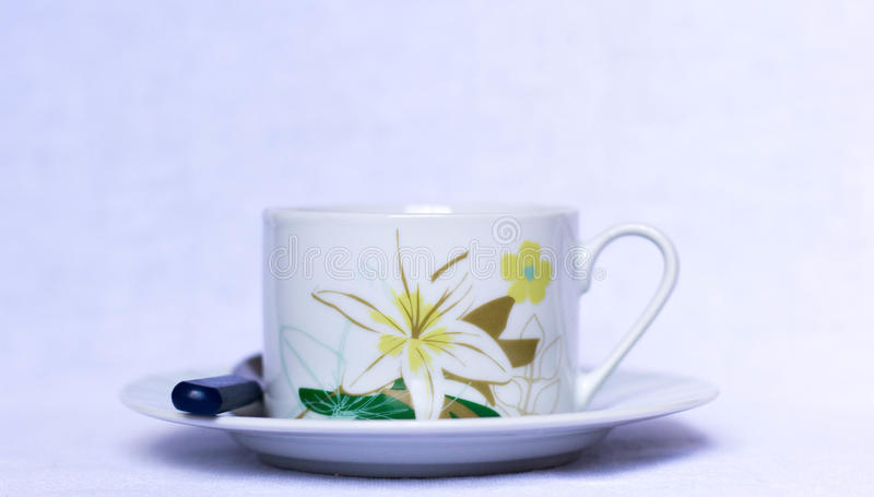 Cup of coffee with floral details on a plate stock photo
