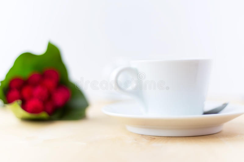 Cup with coffee, flower on wooden table in morning time. Cup with coffee, flower on wooden table. Valentine`s day, 8 march, birthday celebration concept. Soft royalty free stock image