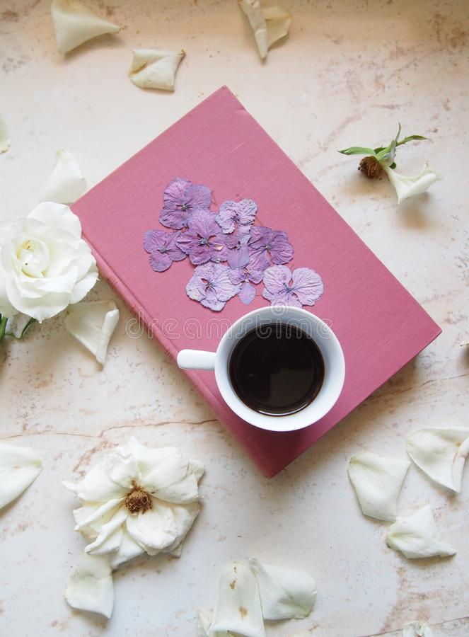 A cup of coffee with flowers stock photo