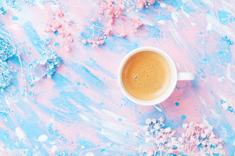 Cup of coffee and flowers on colorful table top view. Flat lay style. Creative breakfast for Woman day. Punchy pastel. Cup of coffee and flowers on colorful royalty free stock photography