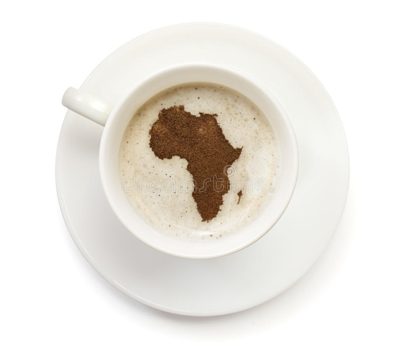 Cup of coffee with foam and powder in the shape of Africa.(series) stock photography