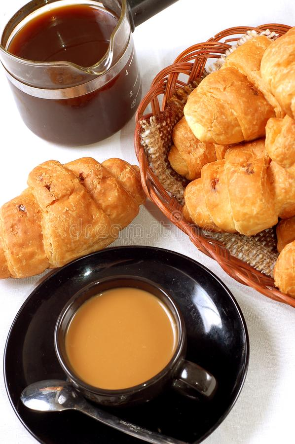 Cup of coffee with fresh croissants stock photos