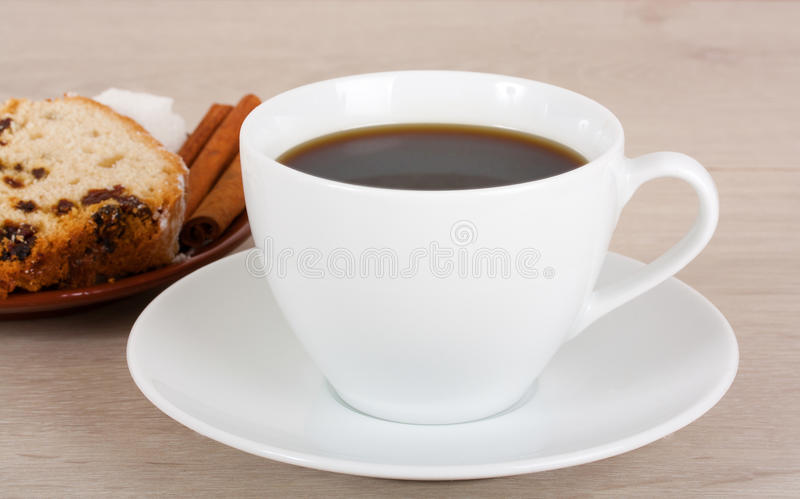 Cup of coffee and fruitcake on a saucer. stock photography