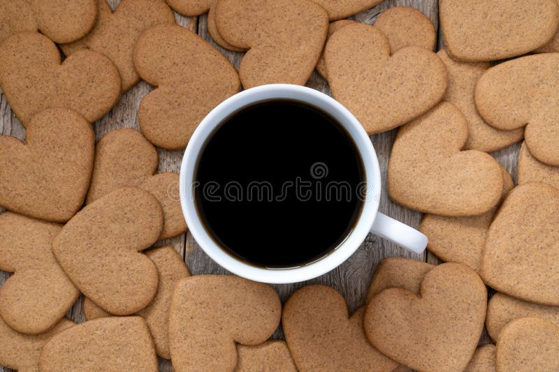 Cup of coffee with a gingerbread cookies royalty free stock photos