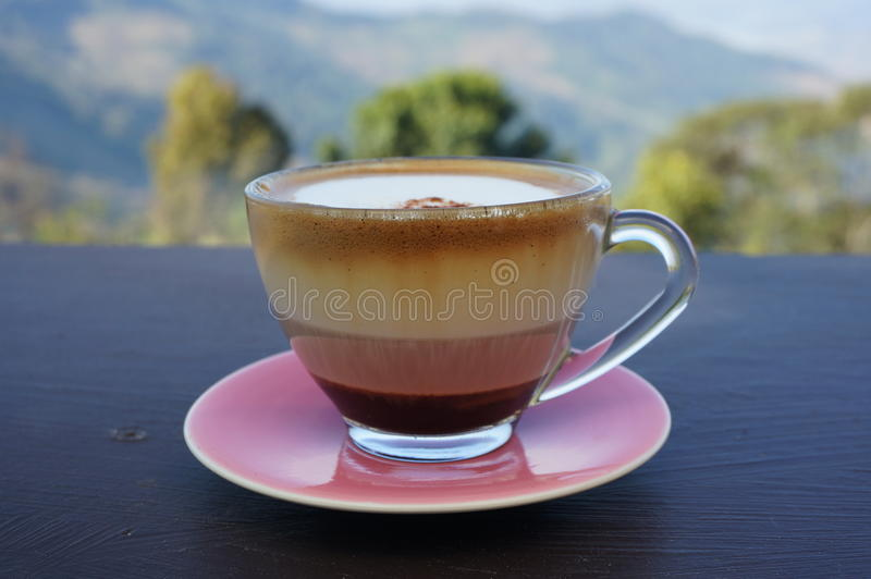 A cup of coffee in a glass cup royalty free stock photos