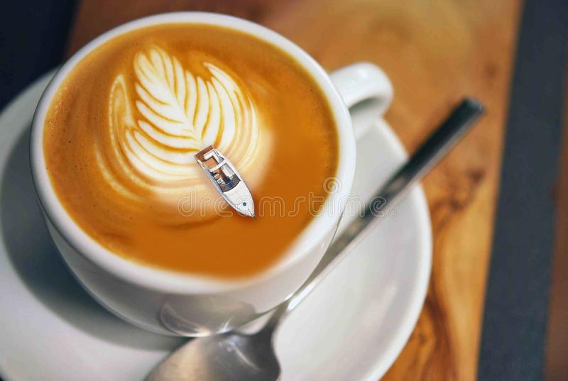 In the cup of coffee goes speed boat. stock images