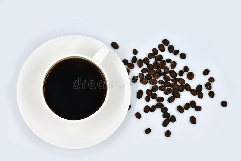 Cup of coffee and grains on a plain white background, Top view or Flat lay stock images