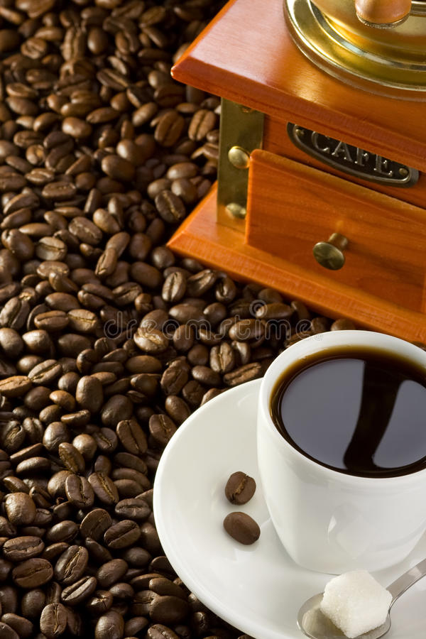Download Cup Of Coffee And Grinder Royalty Free Stock Photo - Image: 22645285