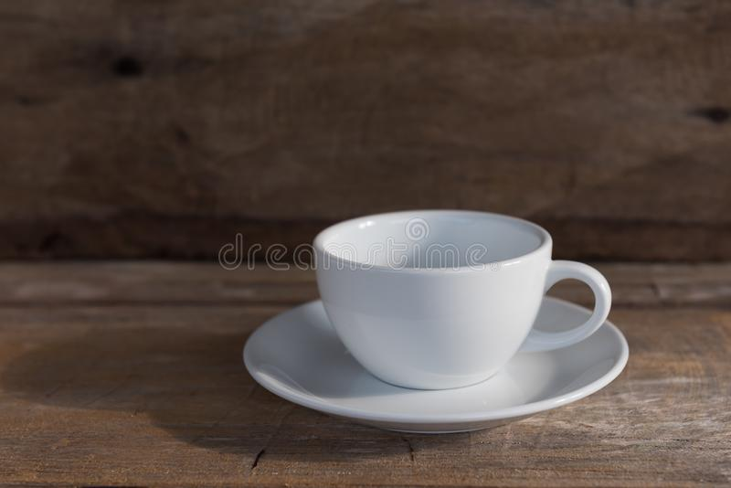 Cup of coffee on grunge wood table in vintage style,still life royalty free stock photography