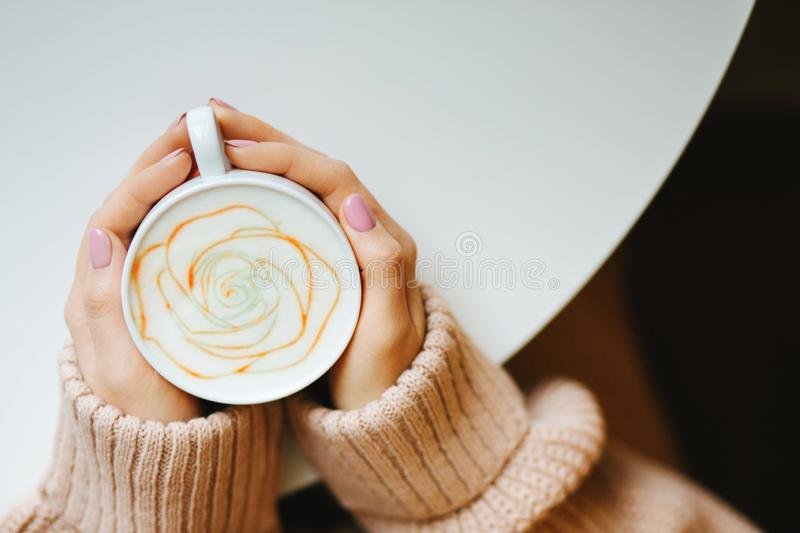 Cup with a coffee in the hands stock images