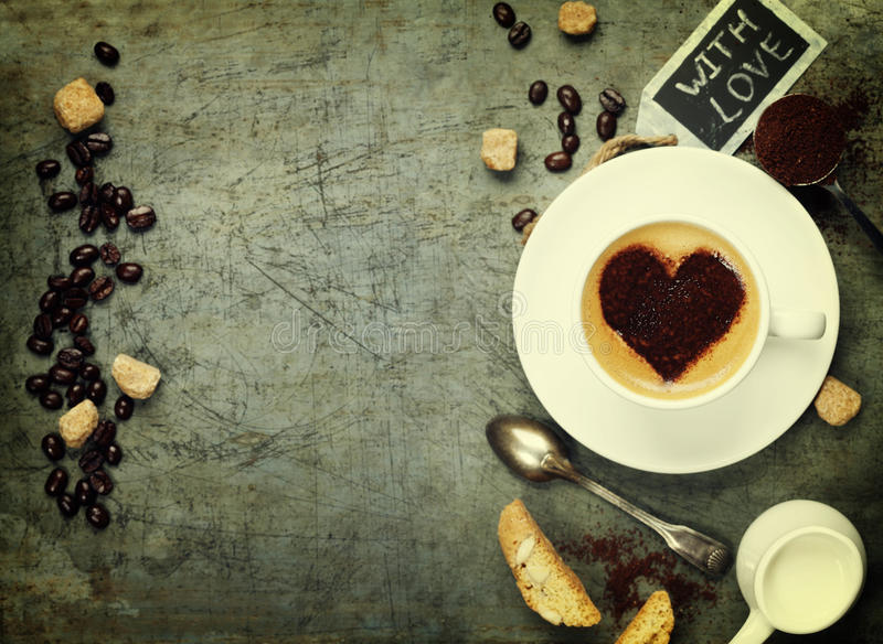 Cup of coffee with heart on foam royalty free stock images