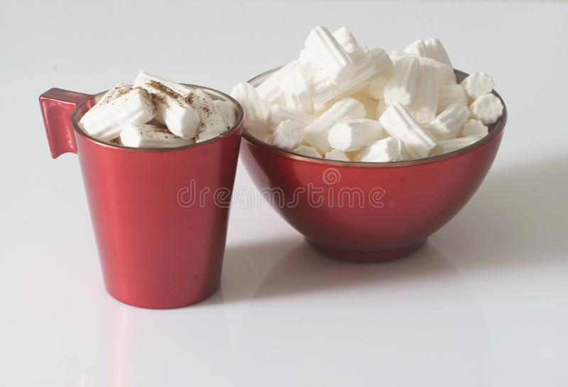 A Cup of coffee or hot chocolate with marshmallows and a red plate on a white background. Close up. Christmas photo. vector illustration