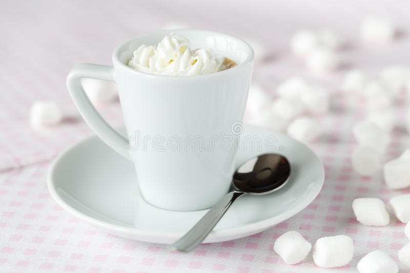 Cup of coffee or hot chocolate with whipped cream on the table a royalty free stock images