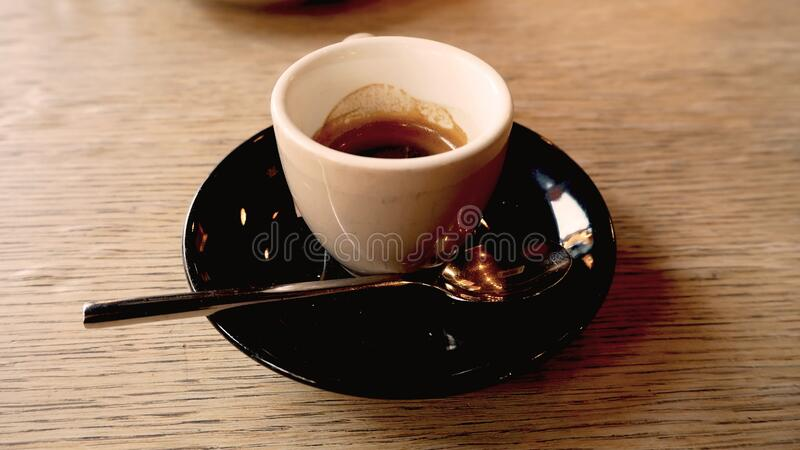 Cup of coffee in the coffee house. On table stock photo