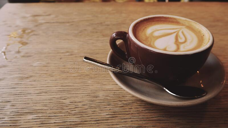 Cup of coffee in the coffee house. On table stock photos