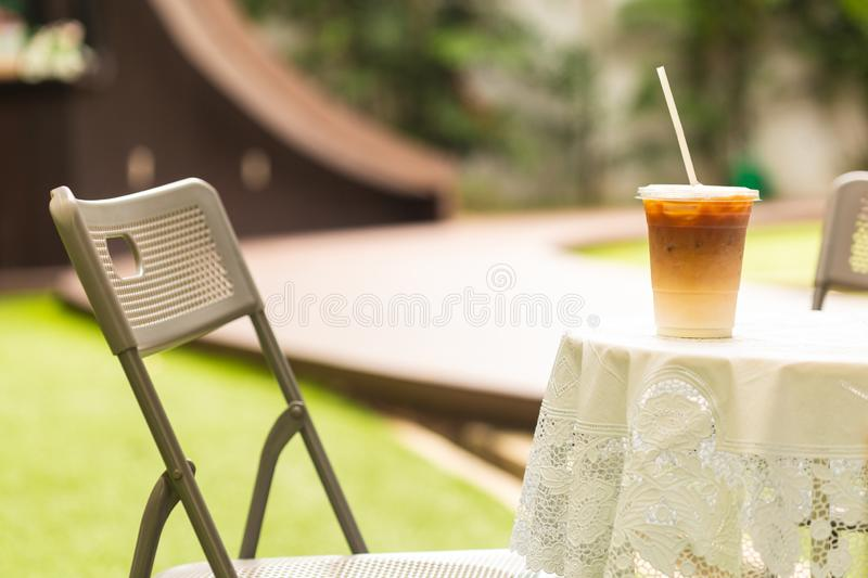 The cup of coffee iced Late. In the cafe`s garden stock images