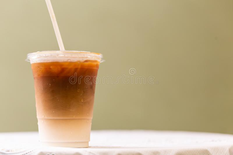 The cup of coffee iced Late. In the cafe`s garden stock photos
