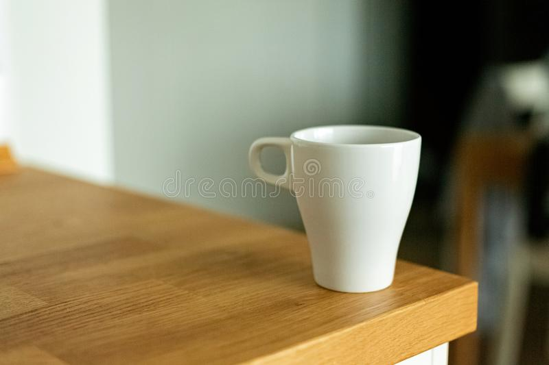 A cup of coffee in the kitchen. Scandinavian style stock image