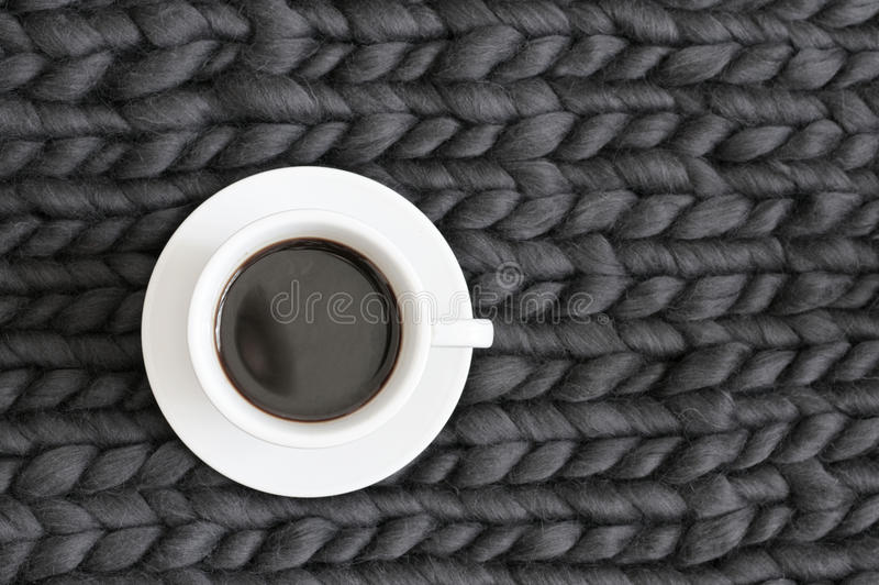 Cup of coffee on knitting stock photo