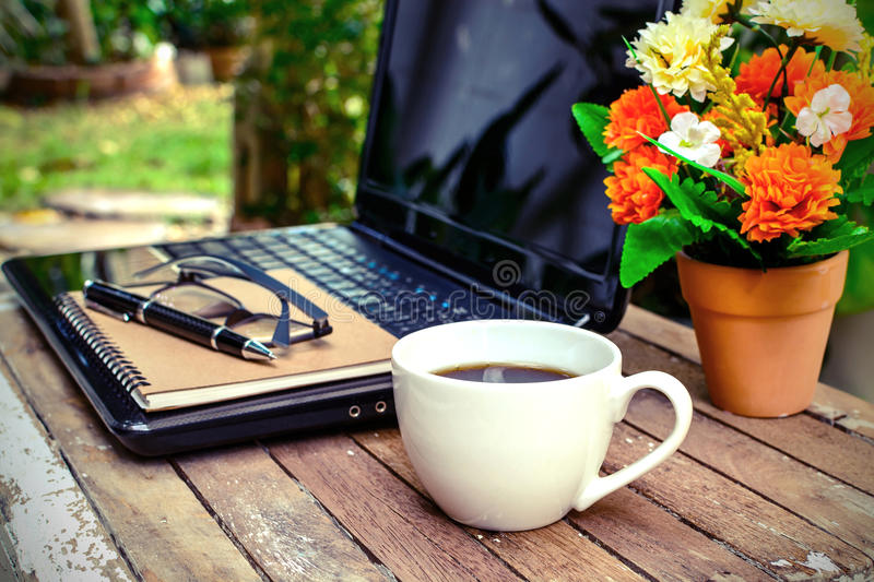 Cup of coffee and laptop stock photography