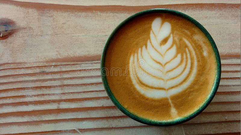 A cup of coffee with latte art royalty free stock images
