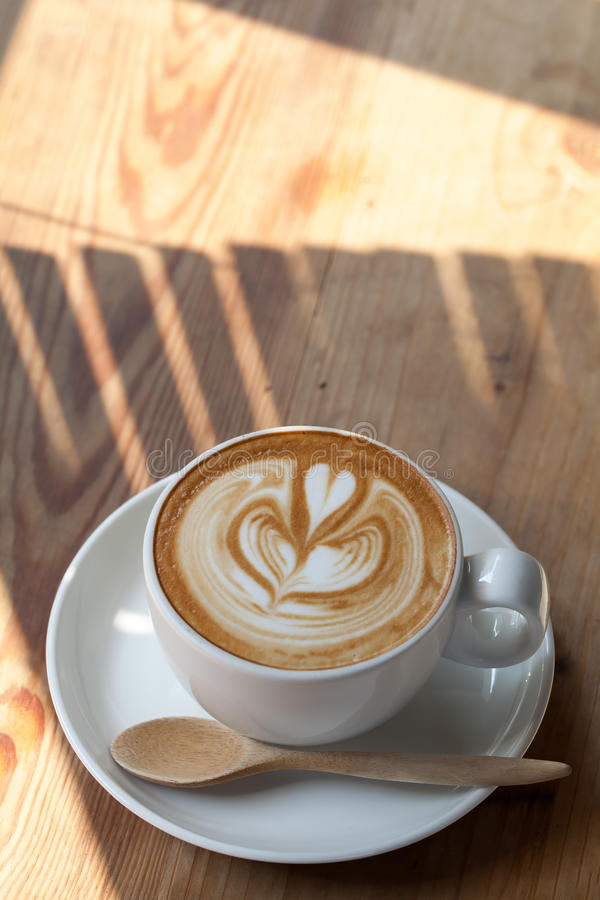 A cup of coffee latte and light breakfast stock photos