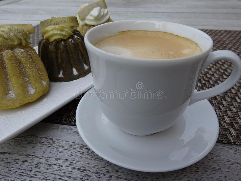 Cup of coffee with layer foam and pastries. stock image