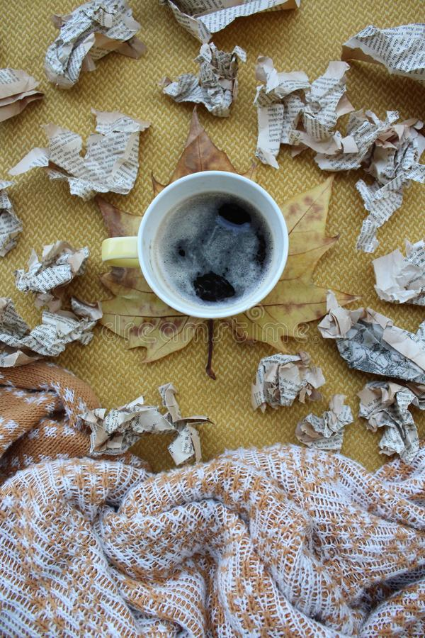A cup of coffee and leaves stock photos