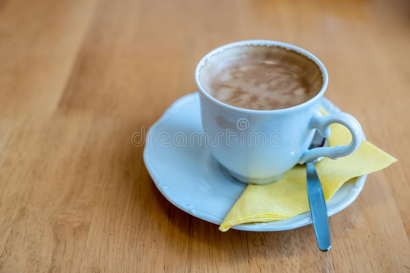 A cup of coffee on a light wooden table stock photos