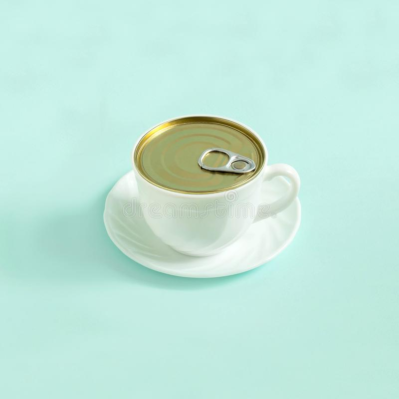 Creative idea: cup of coffee like open tincan stock photo