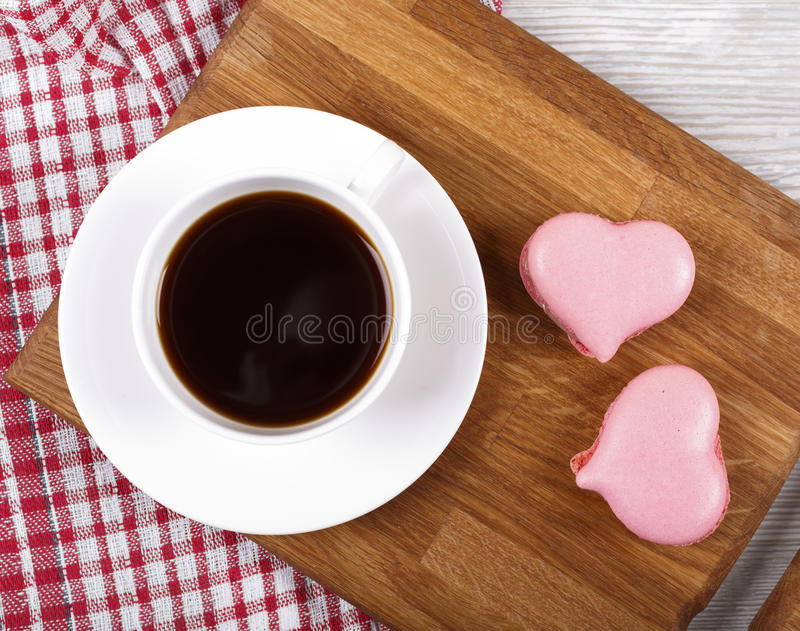Cup of coffee with macaroons royalty free stock photography