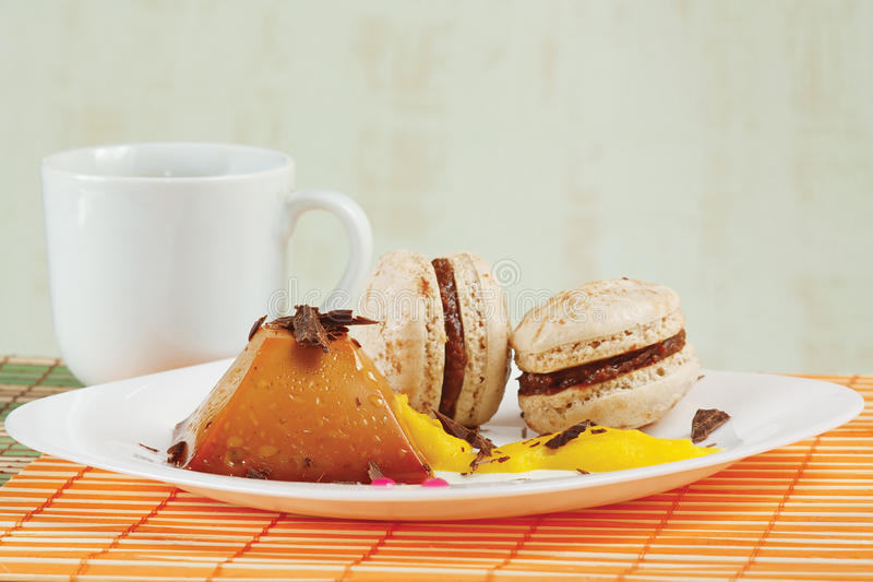 Download Cup Of Coffee, Macaroons And Caramel Pudding Royalty Free Stock Photo - Image: 24635605