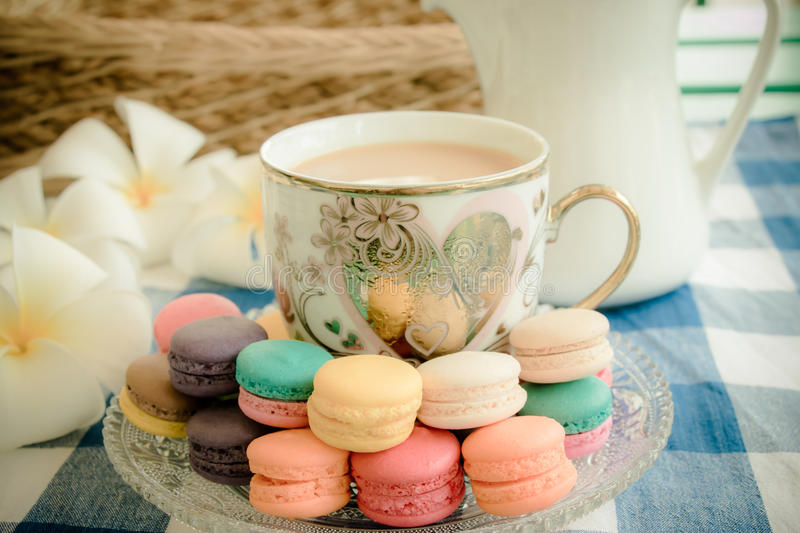 Cup of coffee with macaroons stock photos