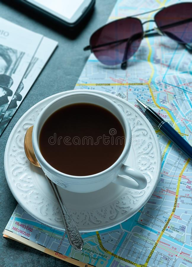 A cup of coffee and a map of Amsterdam royalty free stock image