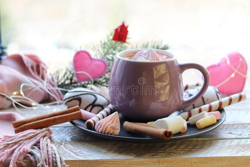 Cup of coffee with meringues and dessert on a plate, Christmas decor, hearts on the windowsill stock photography
