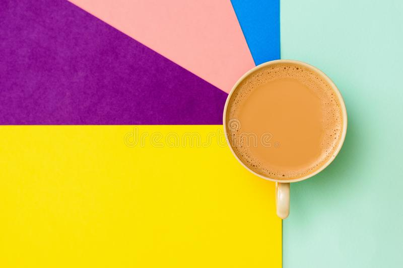 A Cup of coffee with milk on a colorful background. Flat lay stock photos