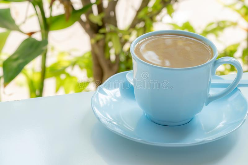 Cup of coffee. Blue cup stock photo